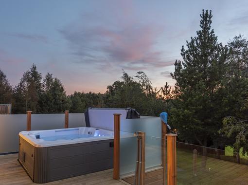 Outdoor Hot tub on the verandah at dusk