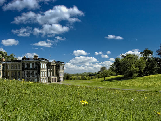 Summer at Calke Abbey with bright blue skies