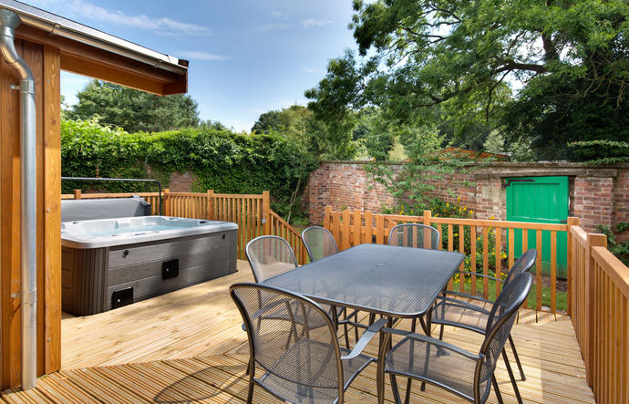 Decking area with outside furniture and outdoor hot tub