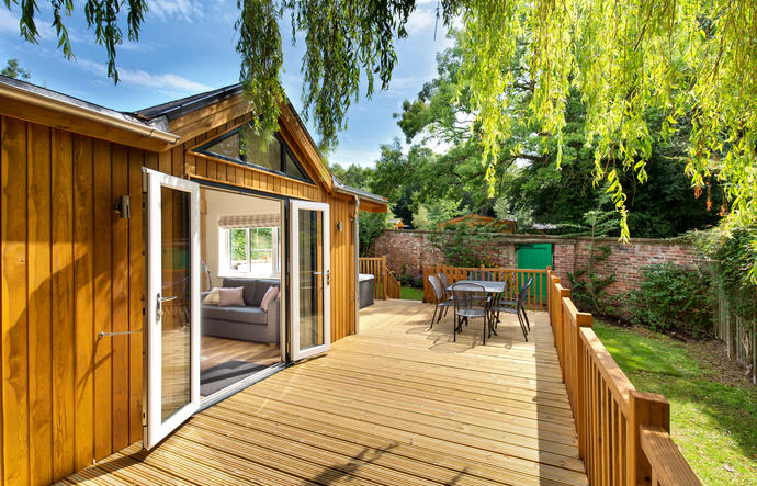 double doors open on to the lodge decking
