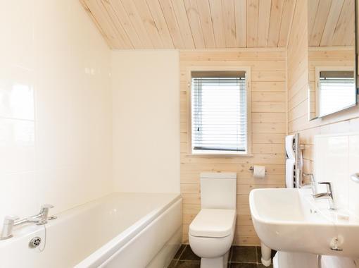 Family bathroom with shower over bath