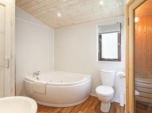 bathroom with corner jacuzzi bath and sauna